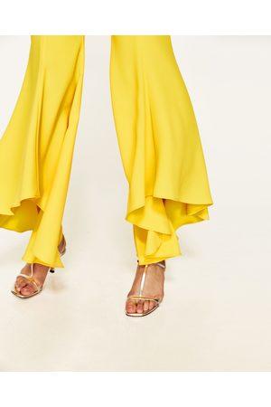Femme Pantalons bootcut - Zara PANTALON FLARE ASYMÉTRIQUE - Disponible en d'autres coloris
