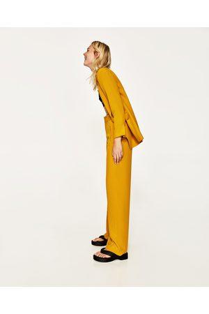 pantalon large zara couleur moutarde