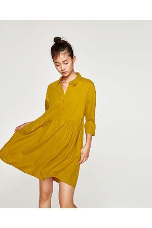 Robe jaune a volant zara