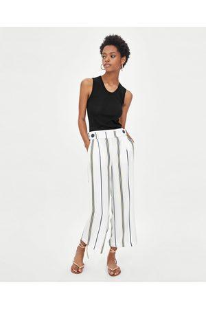 Zara Pantalons larges - PANTALON FLUIDE 7/8 AVEC CEINTURE