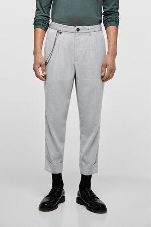 Zara Pantalons larges - PANTALON FLUIDE STRUCTURÉ