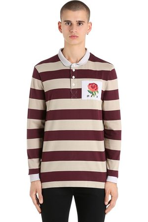 POLO STYLE RUGBY EN COTON À RAYURES ET PATCH ROSE