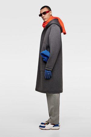 Zara Manteau technique à capuche
