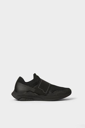separation shoes 798eb f6864 Zara Tennis à élastique noires