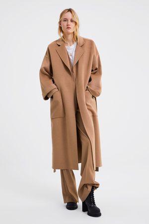 Zara Manteau avec poches et ceinture