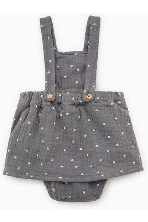 Zara Jupe avec bretelles et étoiles