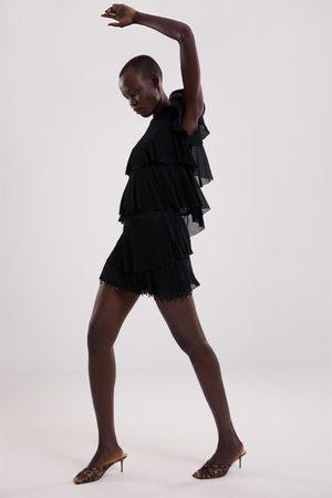 Zara Mini jupe à verroteries
