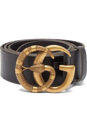 Gucci Ceinture en cuir à boucle serpent GG