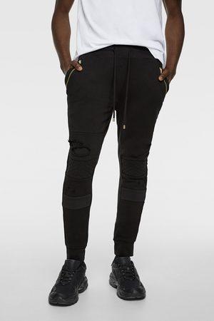 Zara Pantalon de jogging style motard à déchirures