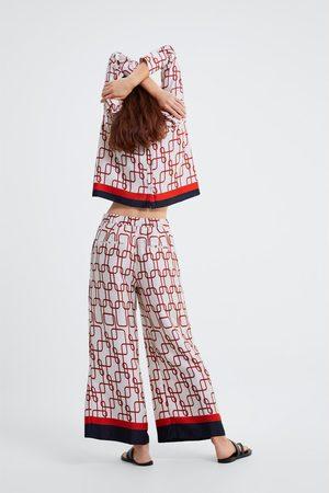 Zara Pantalon à imprimé nœuds