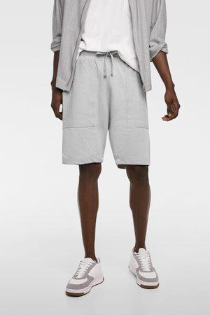 Zara Bermuda avec poches