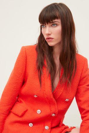 Zara Veste en tweed avec bouton en perle