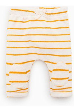 Zara Pantalon à rayures et genouillères