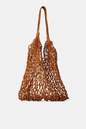 Zara Sac shopper en cuir tressé