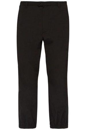 Prada Pantalon en nylon martelé à ourlets zippés