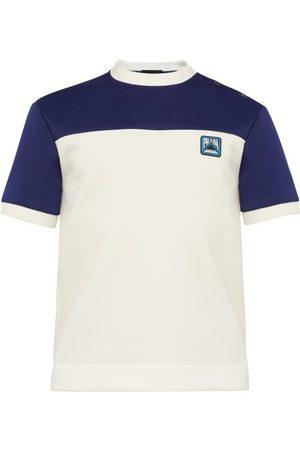 Prada T-shirt à boutons et logo