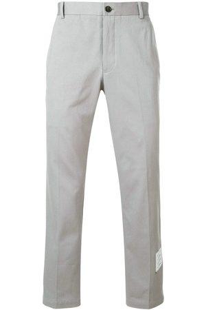 Thom Browne Pantalon de costume à patch logo