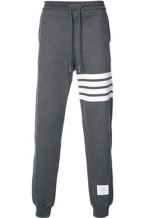 Thom Browne Pantalon de jogging à détail rayé
