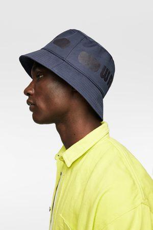 Zara Chapeau de pluie avec inscription