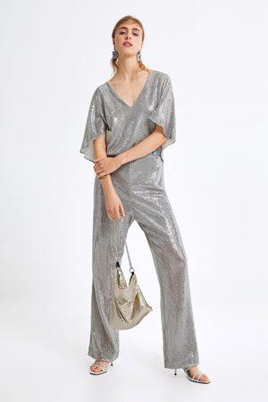 Zara Combinaison avec manches cape brillante