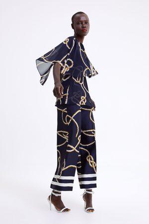 Zara Pantalon jupe-culotte à imprimé nœud