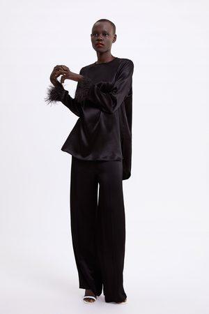 Zara Blouse à plumes