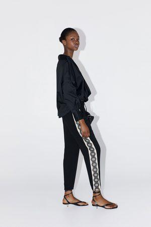 Zara Pantalon à bandes laterales en dentelle