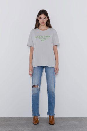 7b0dd15c39d9a0 T-shirt effet délavé à inscription