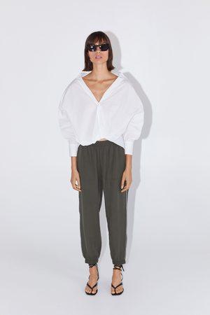 Zara Pantalon de jogging à bandes latérales brillantes