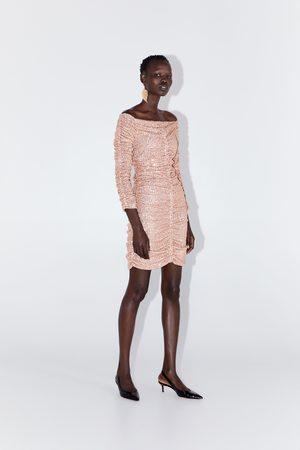 Zara Robe drapée à paillettes
