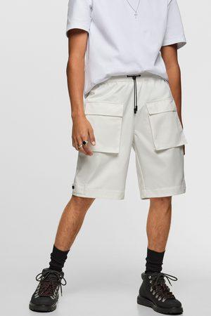 Zara Bermuda technique à poches