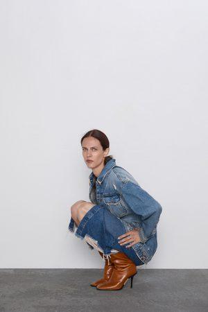 Zara Jupe en jean mi-longue déchirée