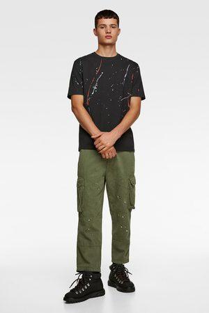 Zara T-shirt à imprimé taches de peinture