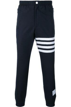 Thom Browne Pantalon de jogging à détails rayés