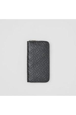 Burberry Portefeuille zippé en cuir Monogram, Black