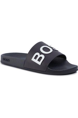 HUGO BOSS Mules / sandales de bain - Bay Slid 50425152 10224455 01 Dark Blue 401