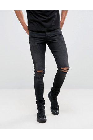 ASOS Jean super skinny 12.5oz avec déchirures aux genoux - délavé