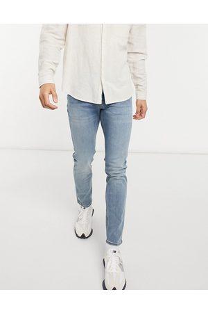 ASOS DESIGN Jean skinny à délavage moyen