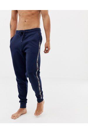 Tommy Hilfiger Pantalon de jogging confort authentique resserré aux chevilles à bandes griffées sur les côtés