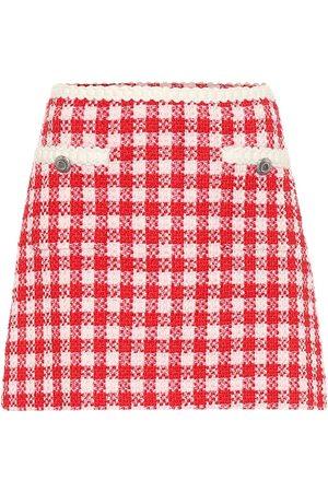Miu Miu Mini-jupe en tweed de laine et coton à carreaux