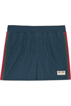 Gucci Homme Shorts de bain - Short de bain en nylon imperméable avec bande Web