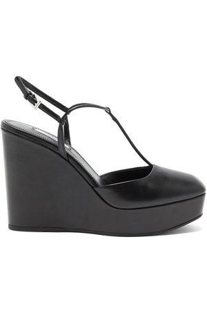 Prada Chaussures compensées carrées en cuir à bride