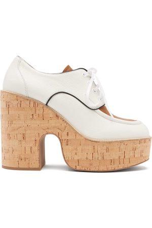 Miu Miu Chaussures en cuir grainé à plateforme compensée