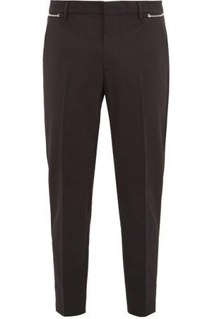 Prada Pantalon zippé en gabardine technique