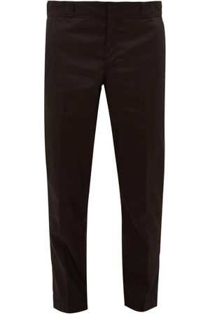Prada Pantalon en gabardine de nylon à plaque logo