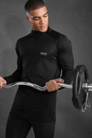 Boohoo Top coupe musculaire raglan avec zip 1/4 MAN Active Homme