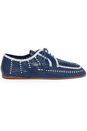 Prada Chaussures bateau - Chaussures bateau en cuir tissé à liseré