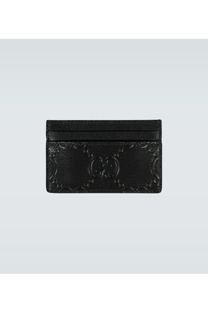 Gucci Porte-cartes gravé GG en cuir