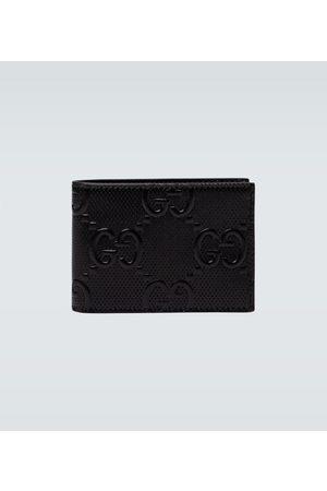 Gucci Portefeuille en cuir gravé GG