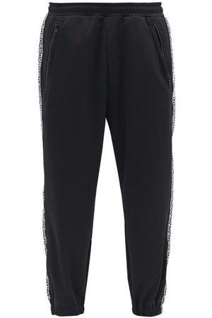 7 MONCLER FRAGMENT Pantalon de jogging en jersey à broderie